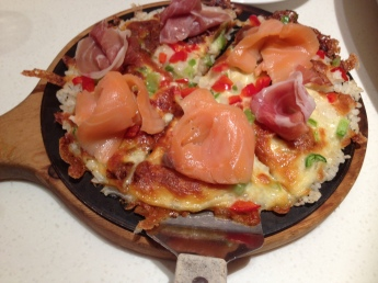 Rice as the crust. Really. It was quite delicious but oily. I hadn't had lox (salmon) on pizza before- wow to the results!