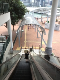Down the escalator.