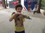 Holding a crocodile, hmm.