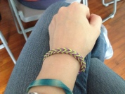 Bracelet was a gift from students welcoming me back. Many are made at lunchtimes in the library. My personal kit is borrowed and used by kids too!