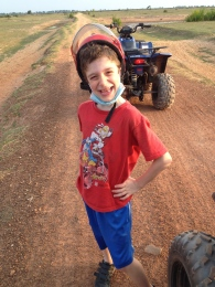 Proud of himself for getting the chance to learn to drive a quad bike.