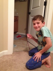 Kiddo liked trying to play with a cat.
