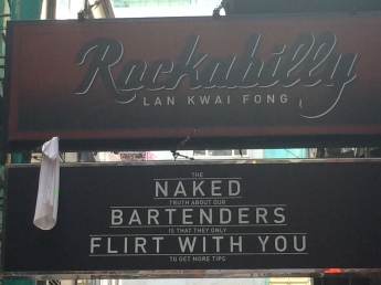 Walking down and passing amusing signs in Lan Kwai Fong
