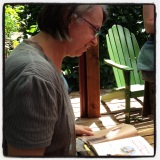 The author, Maggie Rudy, kindly autographing... at Green Bean Books!