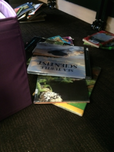 Mystery in library: which kiddo is taking books at hiding/dumping them in different places? Solved later...
