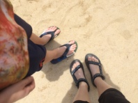 Kiddo and me at the beach. His feet have grown