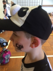 Kiddo supporting Dad's team