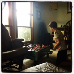 Kiddo is excited to have a foosball table! Thanks Grandpa!