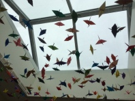 Love the hanging cranes at the high school.